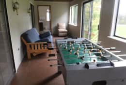 Enclosed porch with Foosball and futon