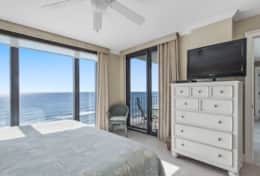 Master bedroom #1 with large ocean view window and slider to balcony
