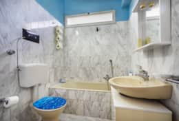 Bathroom with tub and shower and free toiletries (towels provided)