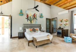 Large air conditioned villa with king bed and tropical decor