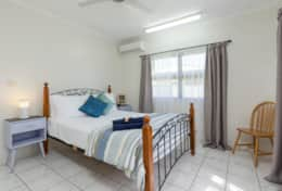 LIght and airy queen bedroom with aircon