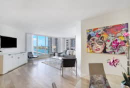 Living room, tv, views of Biscayne Bay, balcony access
