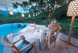 A romantic dinner setup next to the pool