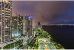 Views off balcony at night of park and Biscayne Bay