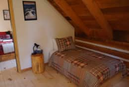 One of two cozy twin beds upstairs