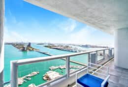 Furnished balcony with views of Biscayne Bay and Sea Isles Marina