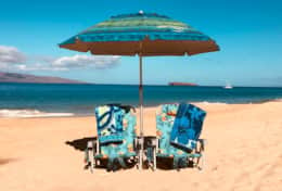 For your beach enjoyment, we share two beach chairs, two beach towels, one umbrella, and ice chest.