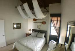 Downstairs private bedroom with air conditioning.