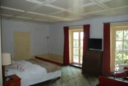 large room with a double bed and a single bed