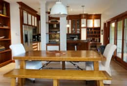 Large, fully equipped kitchen with rustic dining table