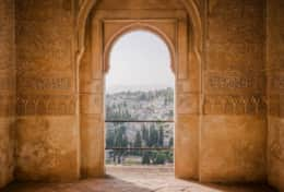 Magical view out of the Alhambra palace - one of the most visited historic buildings in Spain.