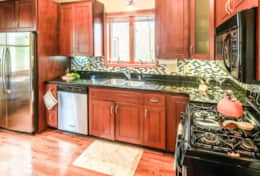 Fully equipped w/ stainless steel appliances, granite countertops and gas range