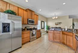 Gourmet kitchen  with stainless steel appliances  puts you in the mood to cook your secret recipe